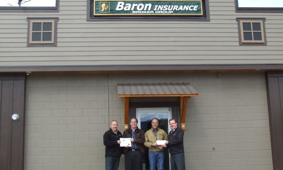 Mayor Cyr, Community Futures' Norm Metcalf along with Arne and Chuck of Baron Insurance, receiving an incentive cheque and certificate for participating in the City of Enderby's business beautification incentive program.