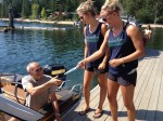 River Ambassadors distributing information material to a boater about zebra and quagga mussels