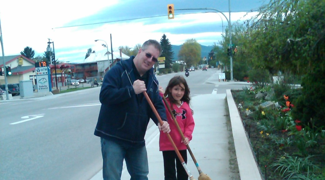Councillor McCune and his daughter chipping in at the Enderby Clean-Up Challenge.