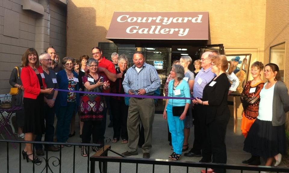 Courtyard Gallery Ribbon Cutting by Mayor Cyr