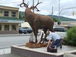 Artist Braden Kiefiuk of Majestic Metal Art affixes his deer sculpture to its base in Enderby