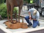 Artist Braden Kiefiuk of Majestic Metal Art nearing completion of deer sculpture installation in Enderby