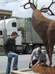 Councillor Case and artist Braden Kiefiuk alongside the Majestic Metal Art deer sculpture in Enderby