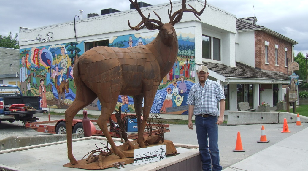 Braden Kiefiuk, artist, alongside his deer sculpture in Enderby