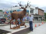 Braden Kiefiuk, artist, alongside his deer sculpture in Enderby