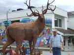 Artist Braden Kiefiuk alongside his deer sculpture in Enderby