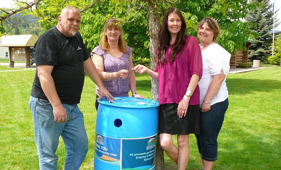Councillors Baird and Knust present keys to recycling containers to the Enderby & District Community Resource Centre as part of a new sustainability initiative in the City of Enderby. Photo by Stacy Pavlov, courtesy of the Okanagan Advertiser.