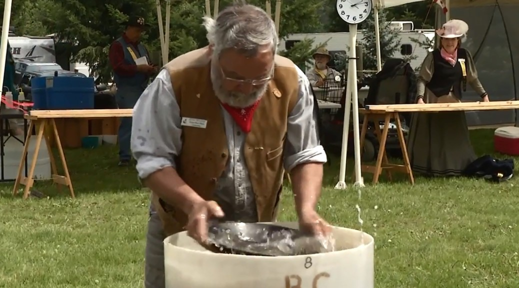 BC Open Gold Panning Championships 2014 photograph of participant panning for gold in Enderby BC