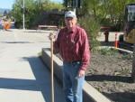 Bill Doorn Sweeping the Highway Sidewalk at Enderby Community Clean Up in 2015 02