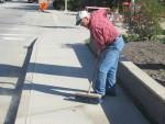 Bill Doorn Sweeping the Highway Sidewalk at Enderby Community Clean Up in 2015