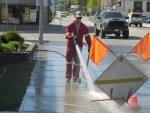 Fire Department Cleaning Sidewalks at Enderby Community Clean Up Day in 2015